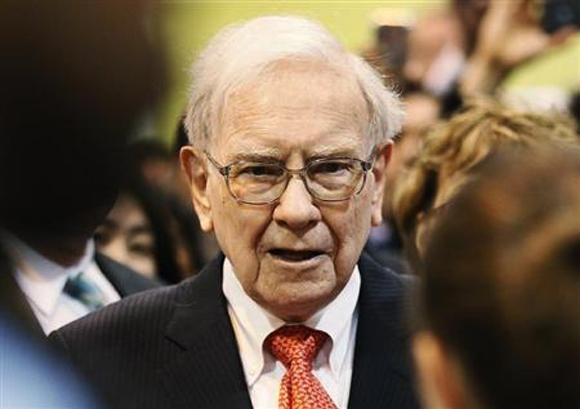 Berkshire Hathaway Chairman Warren Buffett talks with a shareholder before the company's annual meeting in Omaha.