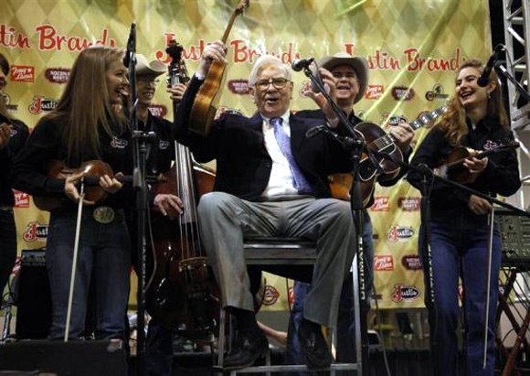 Berkshire Hathaway Chairman Warren Buffett waves his ukulele with The Quebe Sisters Band at the Berkshire Hathaway annual meeting in Omaha.