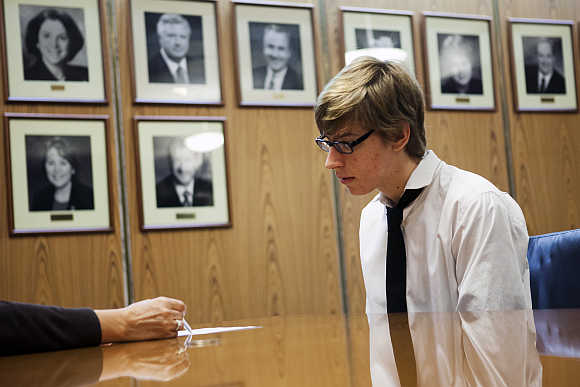 Student Miles Spencer, 17, receives feedback on his resume during an interview as part of work readiness training at the Los Angeles Area Chamber of Commerce in California.