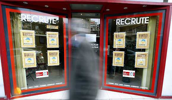 A man walks past an employment agency in Nice, France.