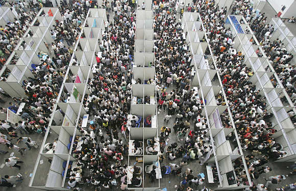 Thousands of job seekers flock to a fair in Chongqing municipality, China.