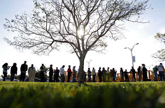 People wait in line looking for jobs during a Job Fair at the Miami Dade College in Miami, Florida, United States.