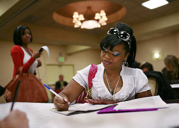 LaShawn McCoy fills out an application for employment as a waitress during a job fair in San Francisco, California, United States.