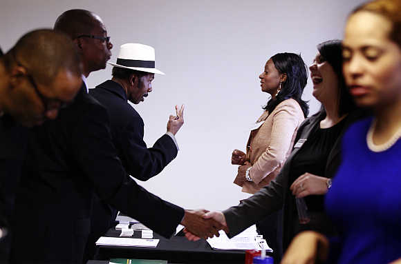 Charles Gates gestures while speaking with a potential employer during the Dr Martin Luther King Jr career fair held by the New York State Department of Labor in New York City.