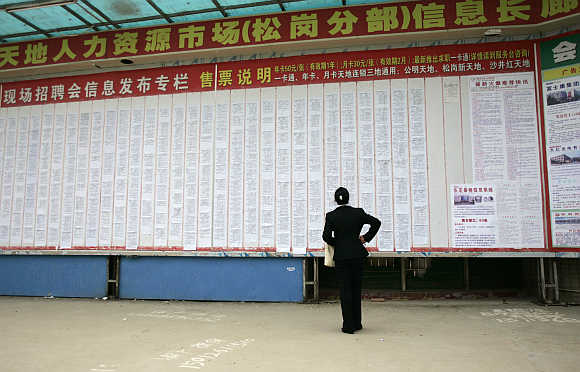 A job seeker looks for work at the near deserted Xintiandi employment centre, in Songgang town, Shenzhen, China.