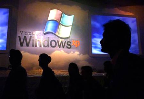 Members of the computer and information technology industries attend the launch of Windows XP operating system in Hong Kong in this November 2, 2001.