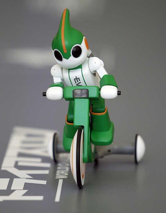 Panasonic's 'Evolta' bike robot, powered by the company's Evolta rechargable batteries, is demonstrated in Tokyo.
