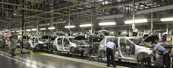 Employees work on the assembly line at the Renault plant in Sao Jose dos Pinhais, Brazil.