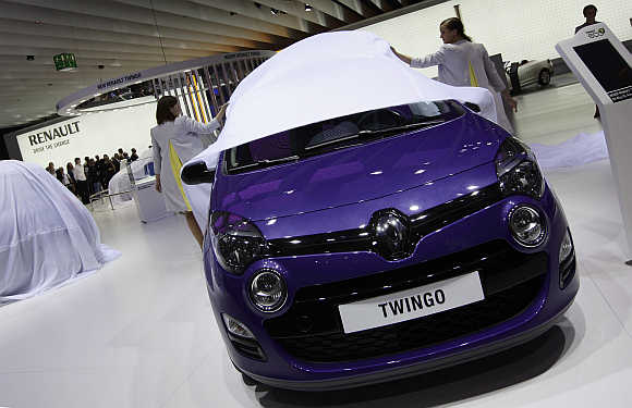 Models at the Renault exhibition booth unveil Renault Twingo in Frankfurt, Germany.
