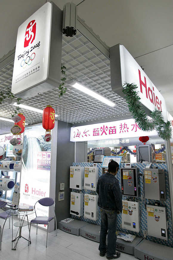 A customer looks at water heaters at a Haier store in Shanghai.
