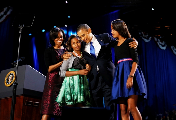 U.S. President Barack Obama celebrates with first lady Michelle Obama and their daughters Malia (R) and Sasha at their election night victory rally in Chicago, November 7, 2012.