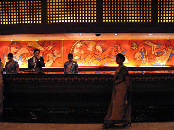 Employees of Taj Mahal hotel in Mumbai at the reception counter.