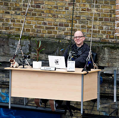 An office worker at a desk suspended outside a building at Peter The Pleater in London, United Kingdom. Taking flexible working to new heights, O2 is proving you really can work anywhere.