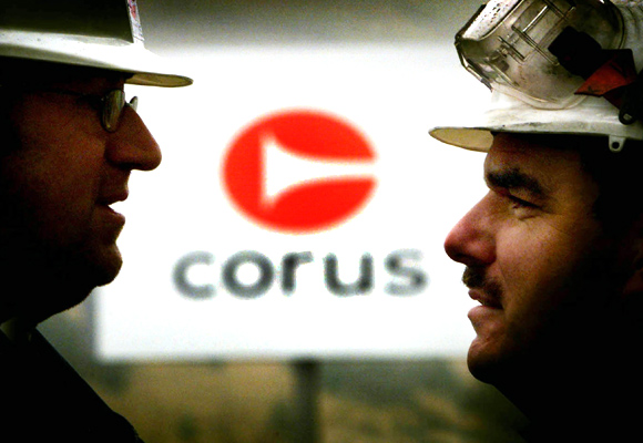 Mike Badham (R) and Michael Hucklebridge, employees of Corus, talk at the entrance to the steel works in Ebbw Vale South Wales.