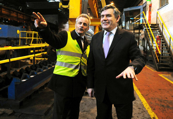 Britain's Prime Minister Gordon Brown speaks with operations manager Andy Wood (L) during his visit to the Corus Steel plant in Corby, central England.