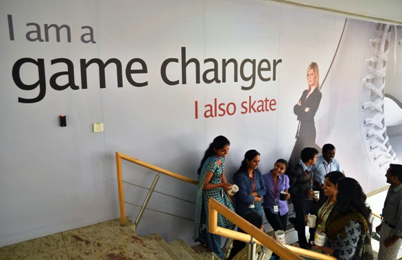 Employees chat with each other during lunch hours at the Indian headquarters of iGate in Bengaluru.