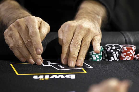 Betting company Bwin Interactive Entertainment logo is pictured with chips and cards on a poker table during an event in Paris, France.
