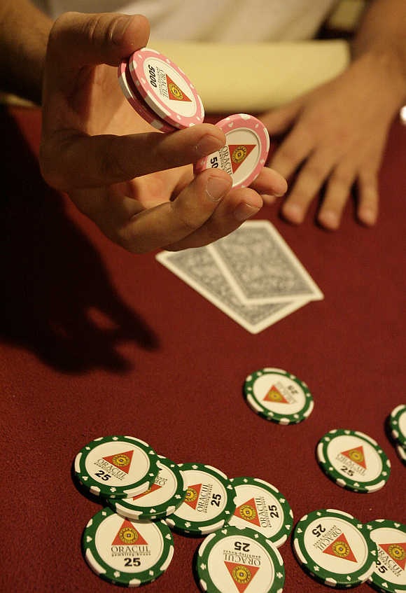 People play poker during the finals of the Russian Masters Poker Cup at the Azov-City gambling zone, some 90km south of Russia's southern city of Rostov-on-Don.