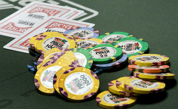 Chips and cards are shown on a poker table during the World Series of Poker no-limit Texas Hold 'em main event at the Rio hotel-casino in Las Vegas, Nevada, United States.