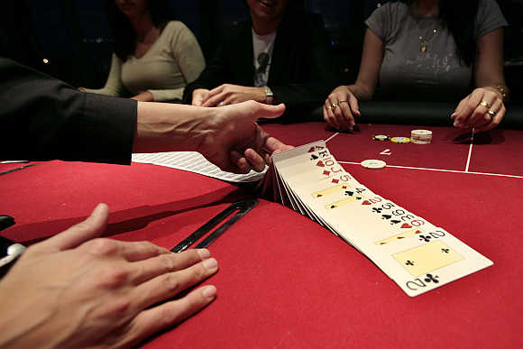 A croupier deals a hand of cards for a poker at the Casino Barriere in Toulouse, France.