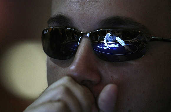 A man reacts during a game at the Betfair Asian Poker Tour in Singapore.