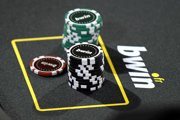 Betting company Bwin Interactive Entertainment logo is pictured with chips on a poker table during an event in Paris.
