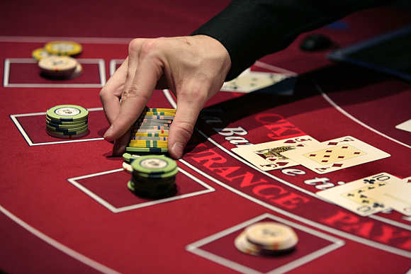 A croupier deals a hand for a poker at the new Casino Barriere in Toulouse, France.