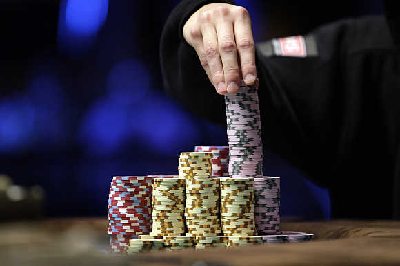 Jonathan Duhamel of Canada stacks chips in the finals of World Series of Poker Main Event at the Rio hotel-casino in Las Vegas, Nevada, United States.