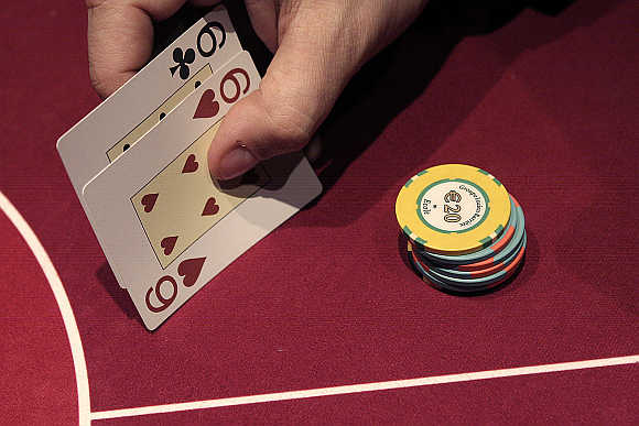 A gambler plays a hand of poker at the Casino Barriere in Toulouse, France.