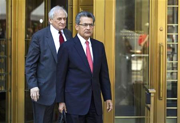 Former Goldman Sachs Group Inc board member Rajat Gupta (R) leaves Manhattan Federal Court with his lawyer, Gary Naftalis, following a guilty verdict in New York June 15, 2012.