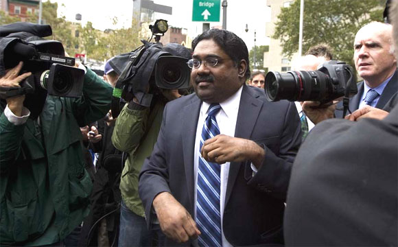 Galleon hedge fund founder Raj Rajaratnam departs Manhattan Federal Court after his sentencing in New York October 13, 2011.