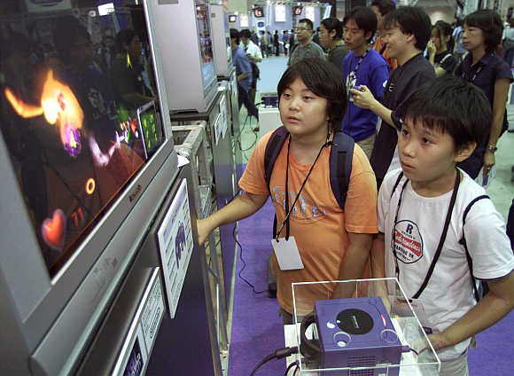 Boys play Nintendo GameCube video game console in Makuhari, 30km east of Tokyo, Japan.
