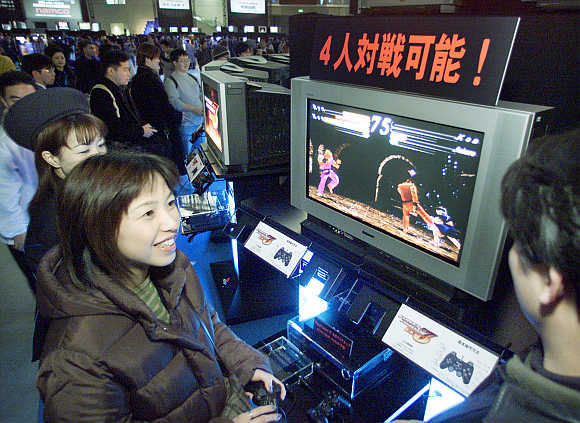 A woman tries out PlayStation in Makuhari, 30km east of Tokyo, Japan.