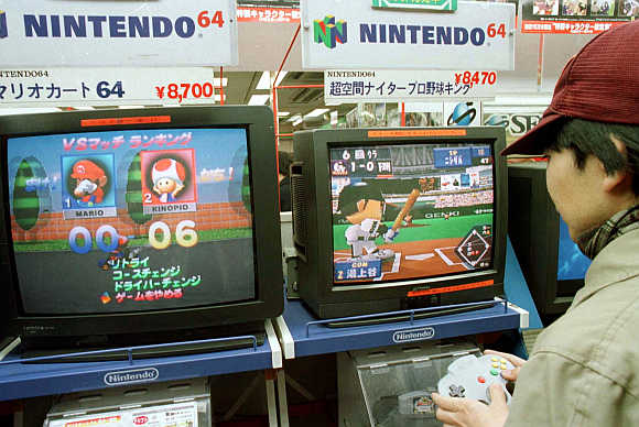 A boy tests his skill on a Nintendo video game in Tokyo's Akihabara electronics district.