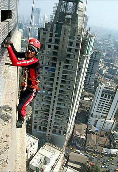Gaurav Sharma, a martial arts trainer, climbs the 45 storey 'Shreepati Arcade' in Mumbai.