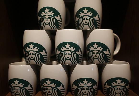 Starbucks coffee mugs are seen on display during the launch of the first Starbucks store in New Delhi.