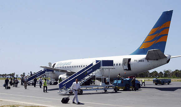 Passengers disembark from a Merpati Nusantara Airlines Boeing 737-228 plane at Dili's Presidente Nicolau Lobato International Airport in East Timor.