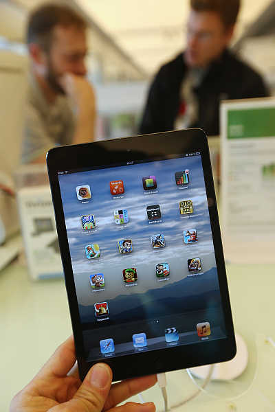 A photographer holds up an iPad mini in Berlin, Germany.