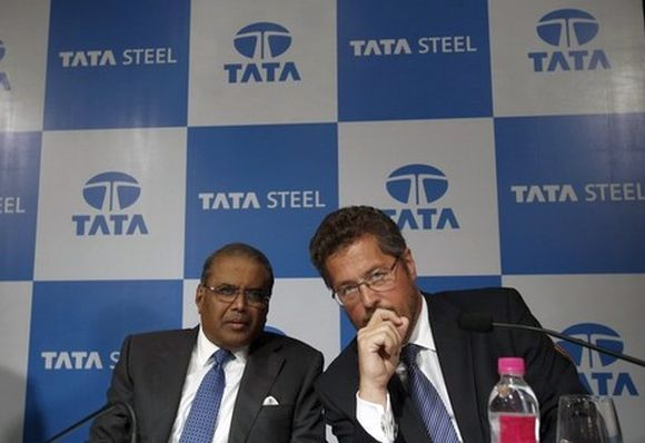 Tata Steel's Managing Director Hemant Nerurkar (L) and Tata Steel Europe's Managing Director Karl-Ulrich Koehler speak to each other before a news conference to announce their fourth quarter results.
