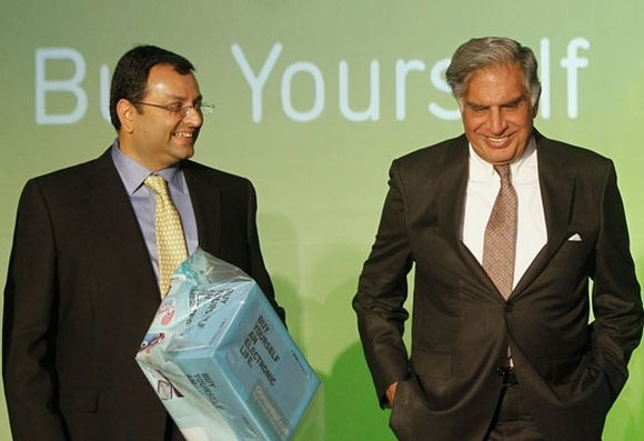 Ratan Tata (R) and Tata Group Chairman Cyrus Mistry attend the launch of a new website for tech superstore Croma in Mumbai.