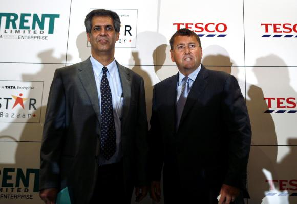 Tesco PLC Director for Asia and Europe Philip Clarke (R) and Trent Ltd Managing Director Noel Tata.