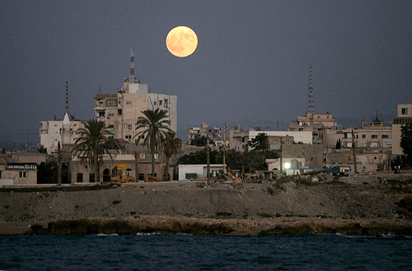 A full moon rises over the port city of Tyre, southern Lebanon.