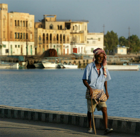 An Eritrean man walks alongside the Red Sea port of Massawa, 150km from the capital of Asmara.