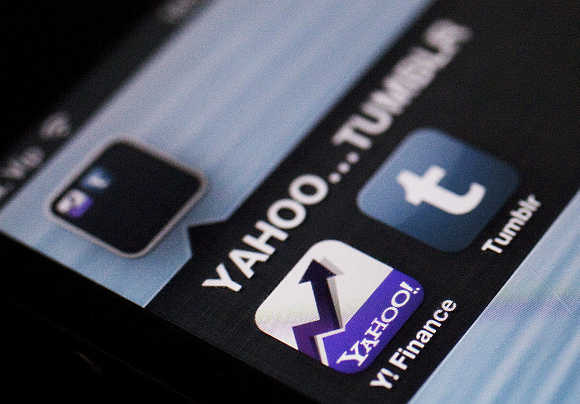 A photo illustration shows the applications of Yahoo and Tumblr on the screen of an iPhone.