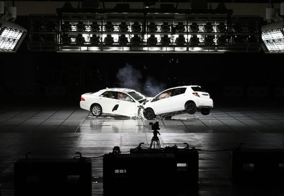 Toyota Motor Corp's Vitz hatchback (R) and flagship Crown sedan are seen colliding in a crash test during the Toyota Safety Technology Media Tour.