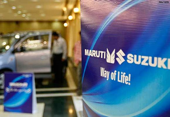 A customer stands inside a Maruti Suzuki's car showroom.