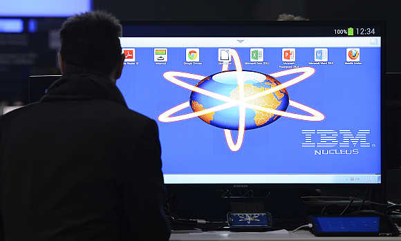 An employee installs a computer at the booth of IBM during preparations at the CeBit computer fair in Hanover, Germany.