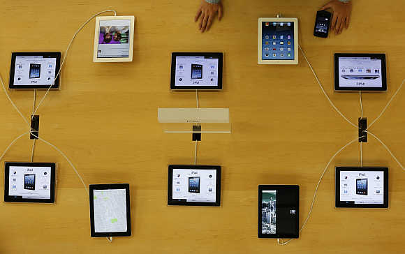 Apple's iPad devices are displayed at its store in Tokyo.