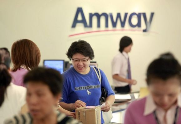 A woman buys Amway products inside the company's sales showroom.