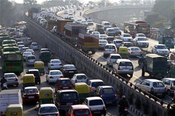 Traffic moves along a busy road in Delhi.